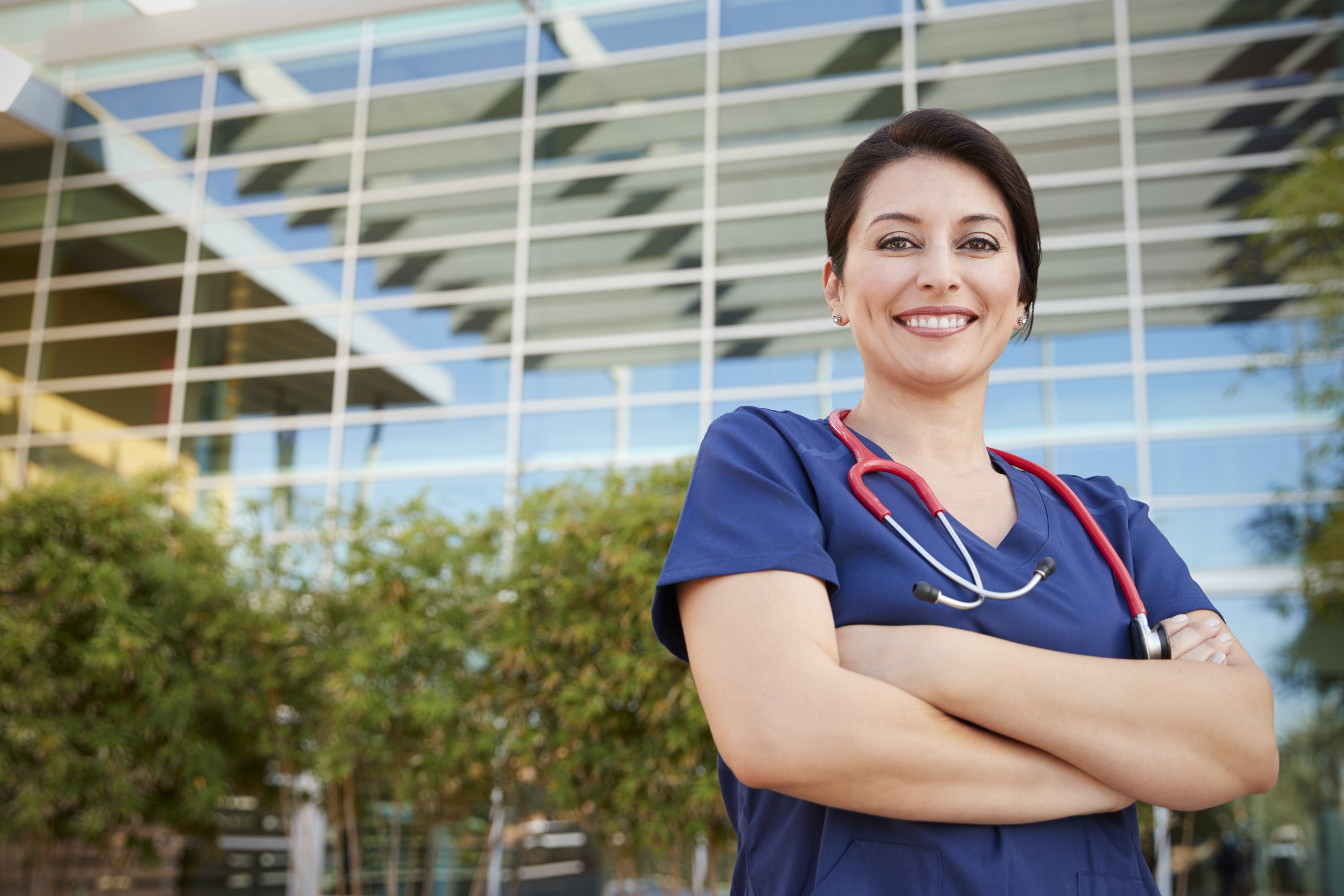 Smiling Hispanic Female Healthcare Worker Outdoors, Portrait